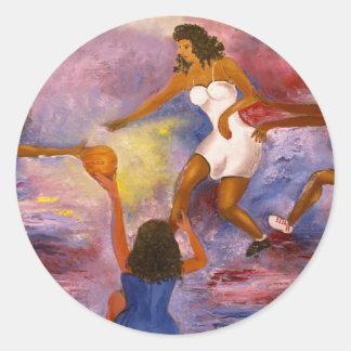 women playing basket ball round sticker