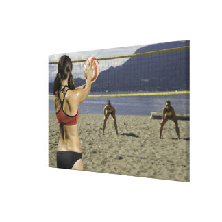 Women playing volleyball on beach canvas print