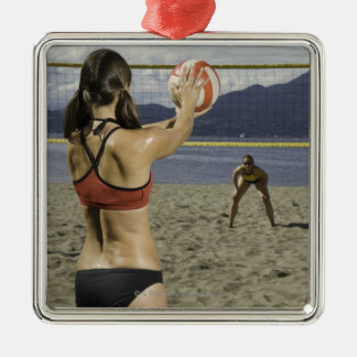 Women playing volleyball on beach christmas ornament