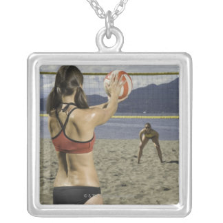 Women playing volleyball on beach silver plated necklace