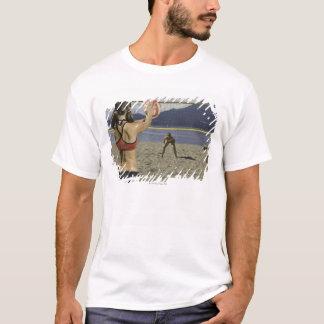 Women playing volleyball on beach T-Shirt