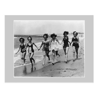 Women run on the beach 1940s post cards