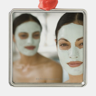Women smiling in beauty mud masks christmas ornament