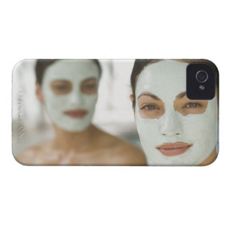 Women smiling in beauty mud masks iPhone 4 case