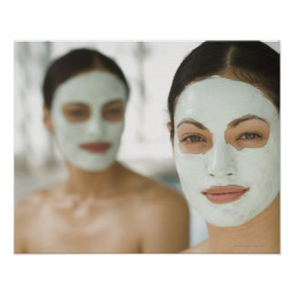 Women smiling in beauty mud masks poster
