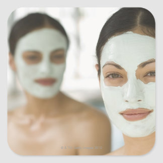 Women smiling in beauty mud masks square sticker