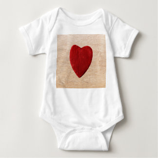 Wood background with heart baby bodysuit