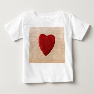 Wood background with heart baby T-Shirt