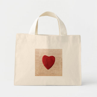 Wood background with heart mini tote bag