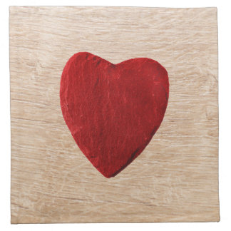 Wood background with heart napkin
