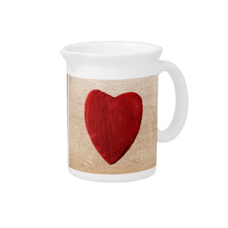 Wood background with heart pitcher