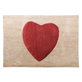 Wood background with heart placemats