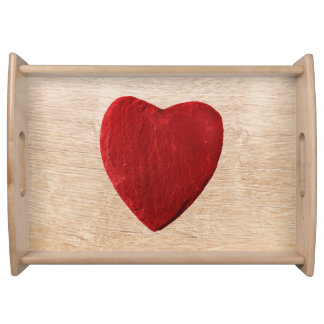 Wood background with heart serving tray