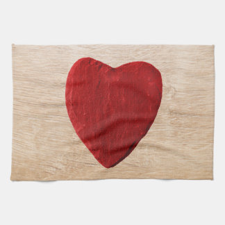 Wood background with heart tea towel