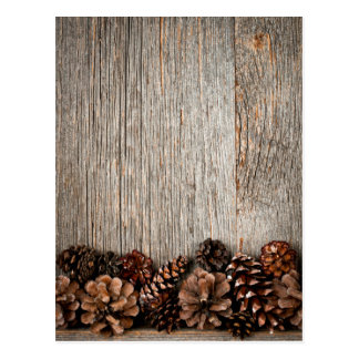 Wood background with pine cones postcard