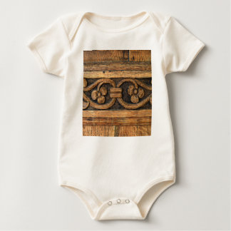wood panel sculpture baby bodysuit