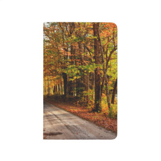 Wood trail with fall foliage journal