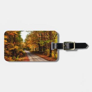 Wood trail with fall foliage luggage tag