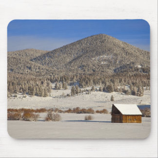 Wooden barn sits in snow near the Boulder Mouse Pad