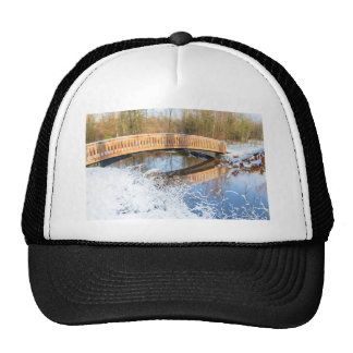 Wooden bridge snow and water in winter season cap