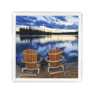Wooden Chairs At Sunset On Lake Shore