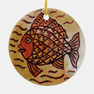 Wooden decor with fish. round ceramic decoration