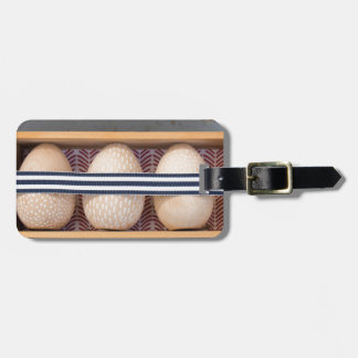 Wooden eggs in a box bag tag