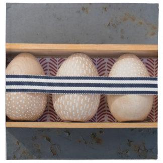 Wooden eggs in a box napkin