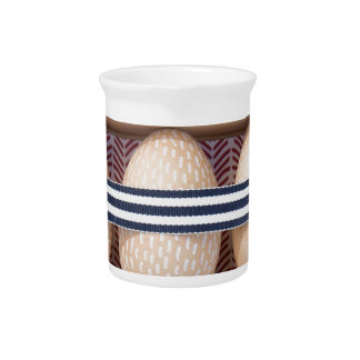 Wooden eggs in a box pitcher