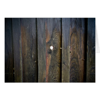 Wooden fence with spyhole greeting card