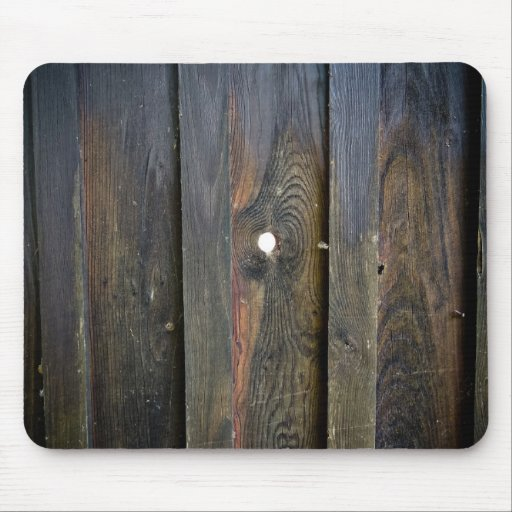 Wooden fence with spyhole mousepads