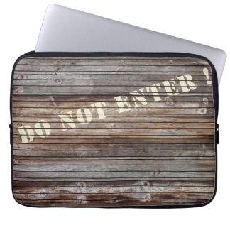Wooden fence with warning computer sleeves