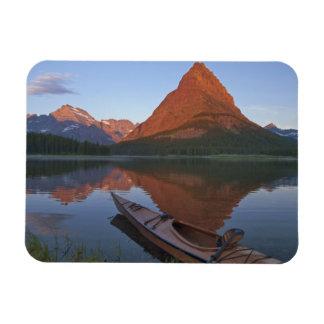 Wooden kayak in Swiftcurrent Lake at sunrise in Rectangular Photo Magnet