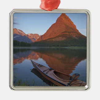 Wooden kayak in Swiftcurrent Lake at sunrise in Silver-Colored Square Decoration