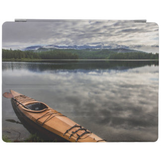 Wooden kayak on shore of Beaver Lake iPad Cover