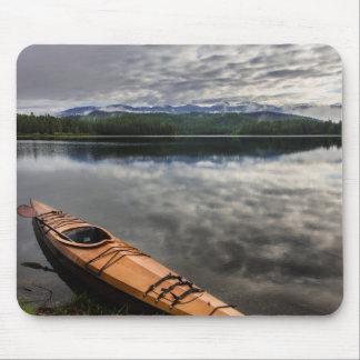 Wooden kayak on shore of Beaver Lake Mouse Mat