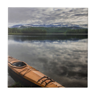 Wooden kayak on shore of Beaver Lake Tile
