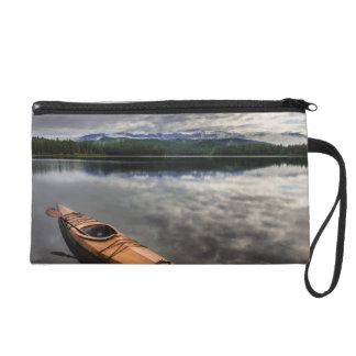 Wooden kayak on shore of Beaver Lake Wristlet