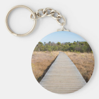 Wooden path in grass and forest winters landscape. basic round button key ring
