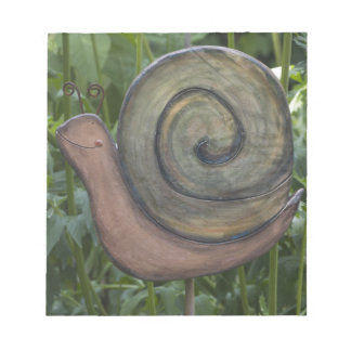 wooden snail in the garden notepad