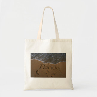 Word Florida in beach sand with wave coming Budget Tote Bag