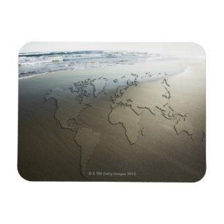 World map on sand magnet