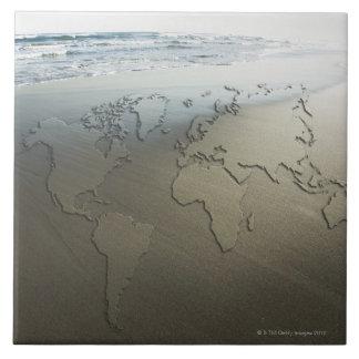 World map on sand tile