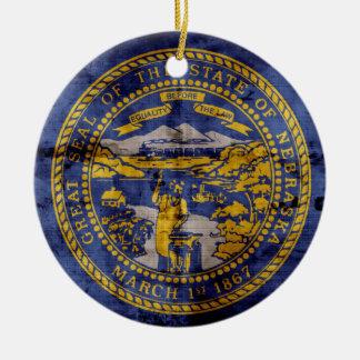 Worn Nebraska Flag; Round Ceramic Decoration