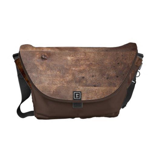 Worn pine board courier bag