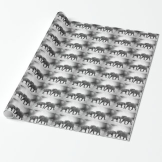 WRAPPING PAPER WITH ROWS OF MOM AND BABY ELEPHANT.