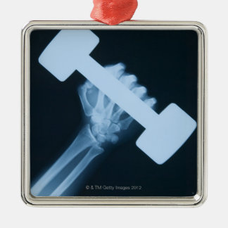 X-ray image of human hand with weight, close-up christmas ornament