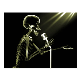 X-RAY SKELETON SINGING ON RETRO MIC - YELLOW POSTCARD