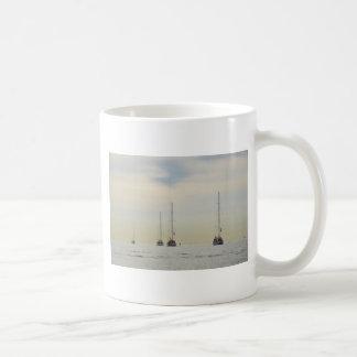 Yachts Heading Out At Dawn Coffee Mug