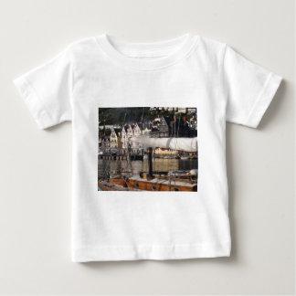 Yacht's smoking chimney. baby T-Shirt